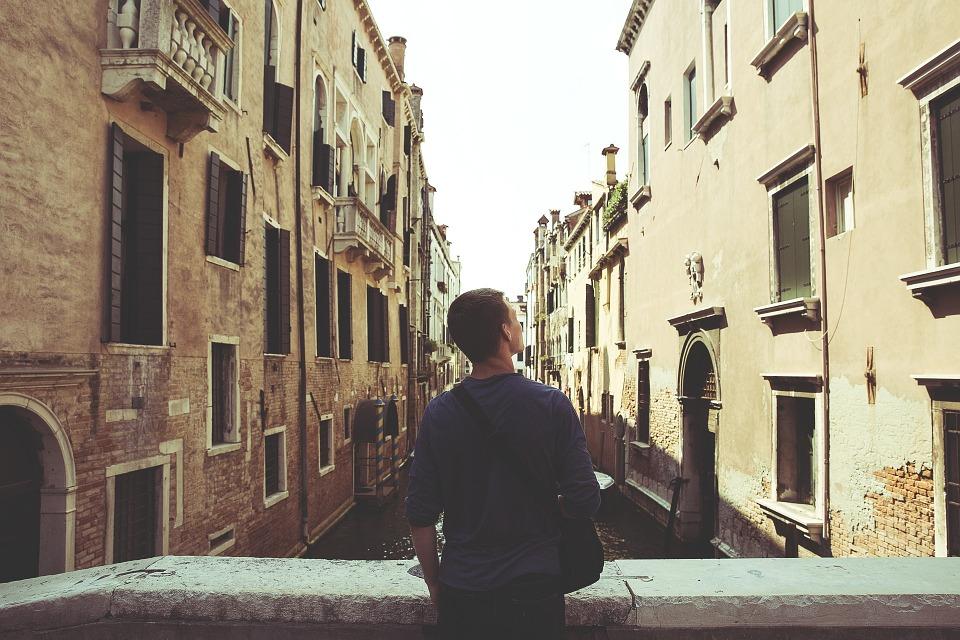 man looking at buildings